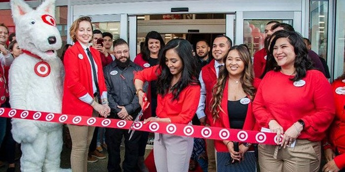 Target employees in a ribbon cutting ceremony.