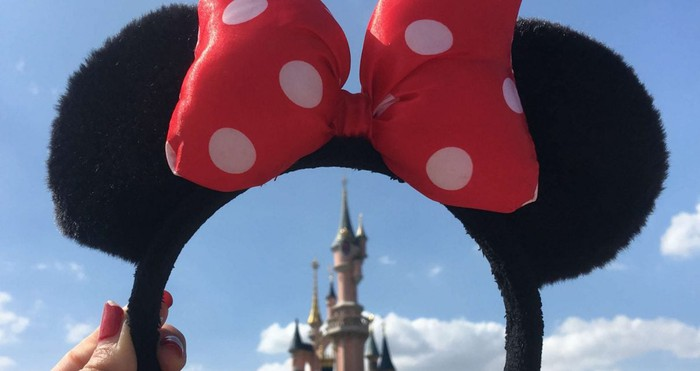 A view of Disney's Castle through a Minnie Mouse headband.