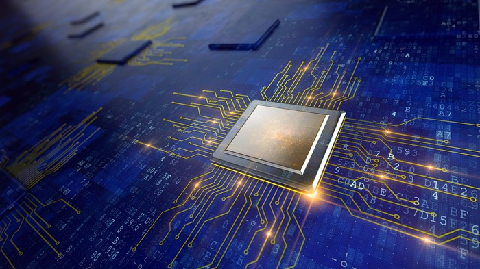 A computer processor on a blue circuit board with brightly lit gold circuit lines shooting out in all directions.