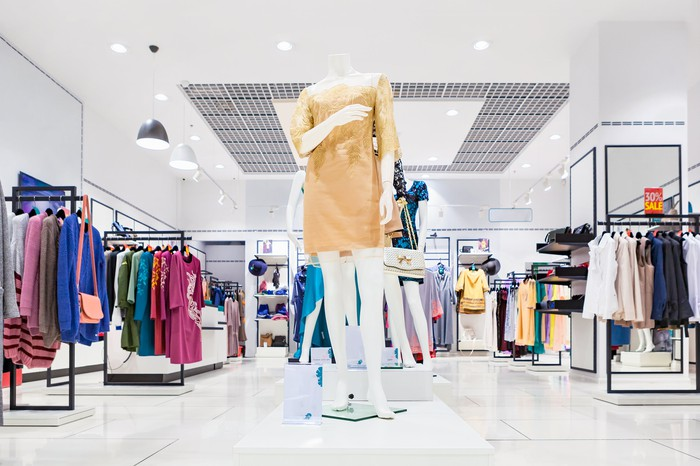 Apparel store featuring racks of clothing
