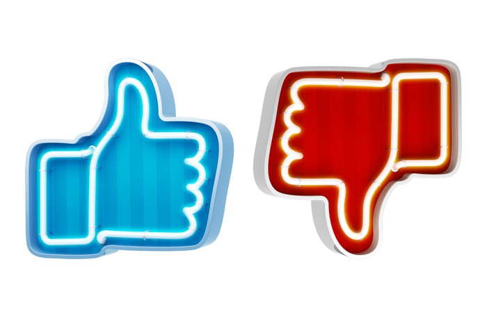 A blue thumbs-up and a red thumbs-down outlined in neon