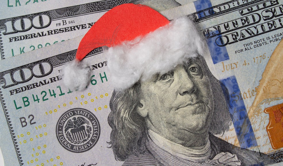 $100 bills with a Santa hat