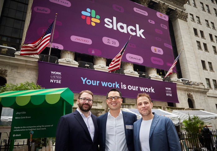 Slack leadership standing outside the New York Stock Exchange the day of the company's direct listing
