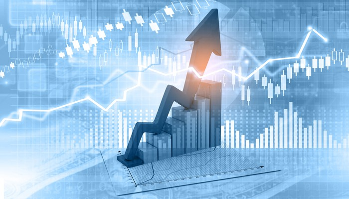 Stock charts with upward arrow