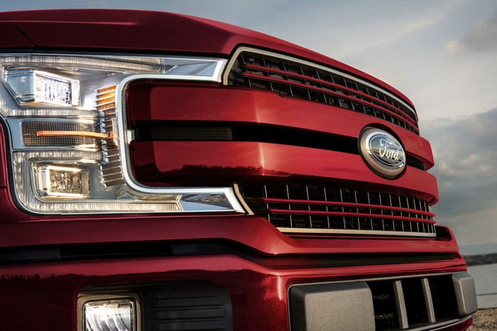 The grille of a red Ford F-150.