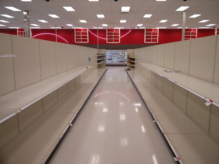 An empty aisle of empty shelves in a soon-to-close-forever retail store