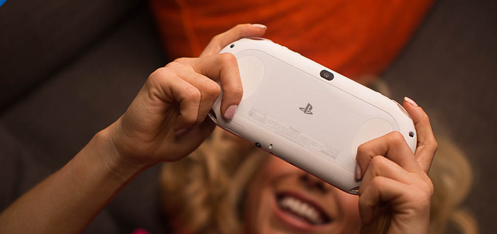 A gamer plays a game on a PS Vita.