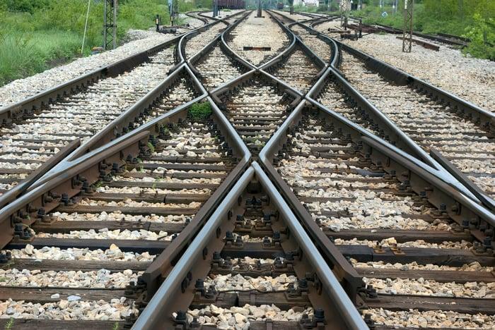 Train tracks at a crossing.