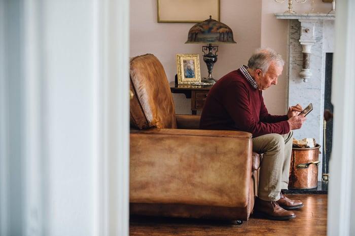 Older man sitting in armchair