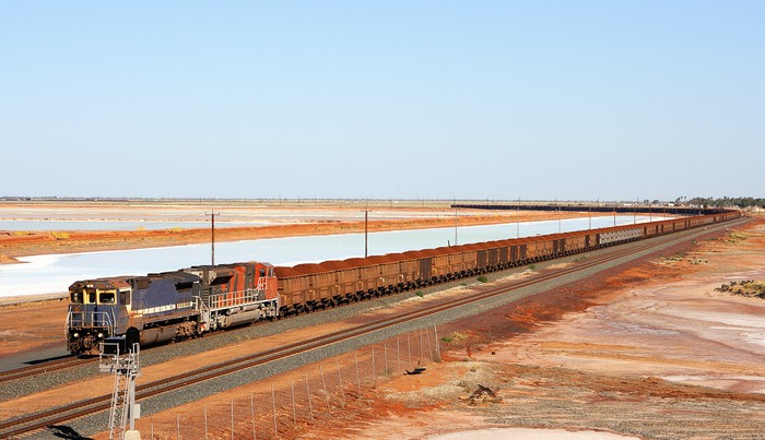 A train carrying iron ore.