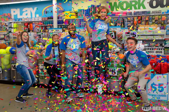 Five Below employees throwing confetti in a store