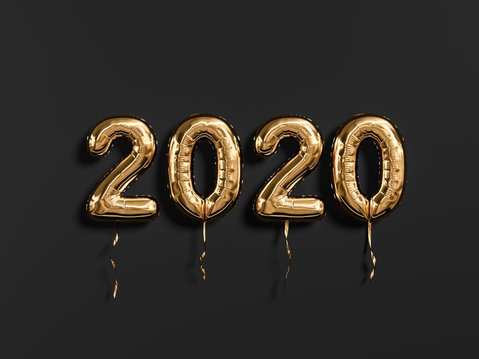 Gold puffy balloons that spell out 2020 against a black background