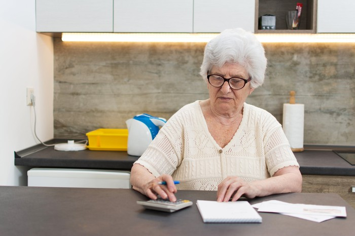 Older woman checking her finances