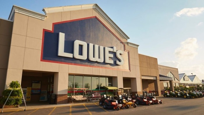 Lowe's retail store with equipment outside, as seen from front.