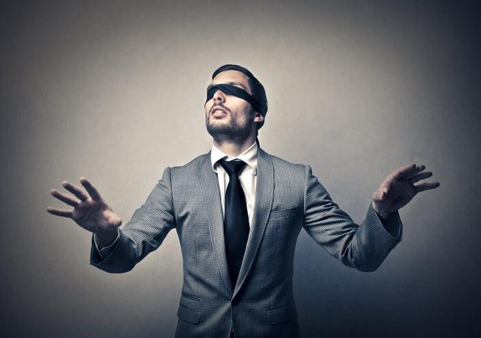 Blindfolded man.