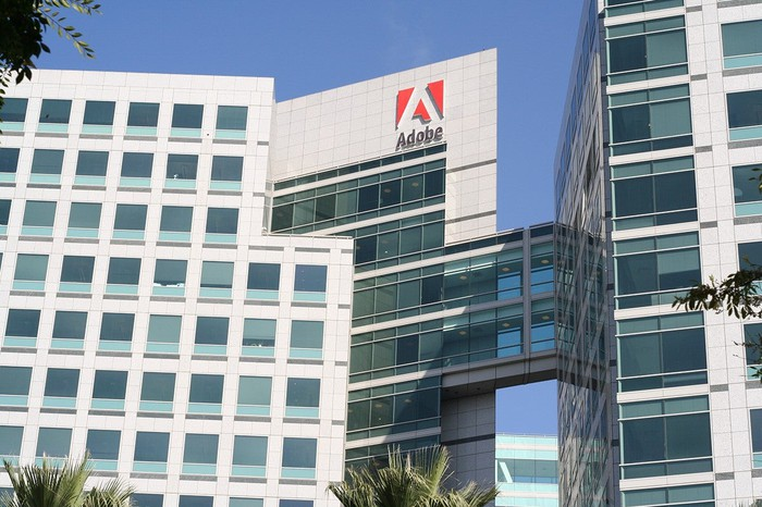 Adobe logo on a company building as viewed from below.