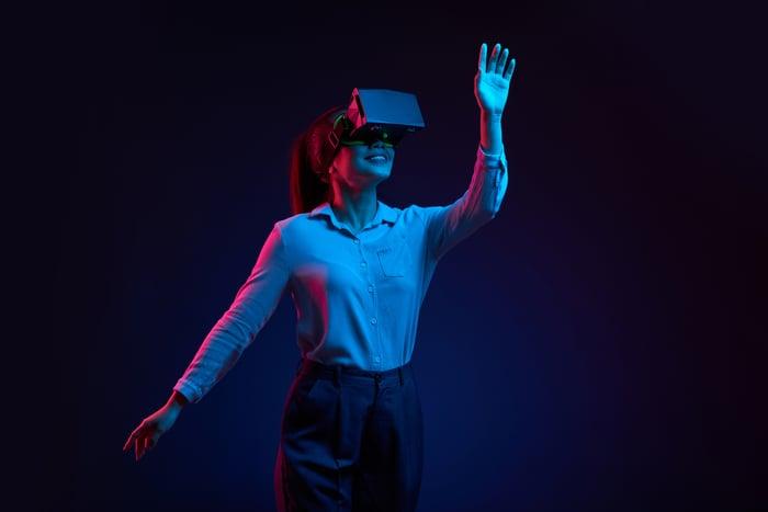 A woman wearing a virtual reality headset.