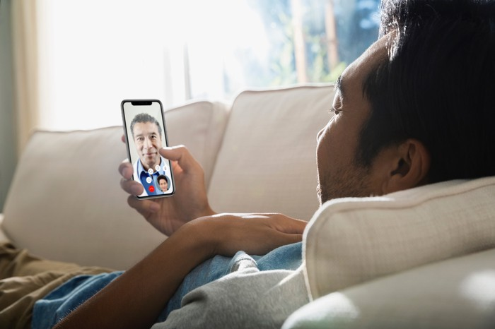 Man having a virtual healthcare visit on a smartphone.