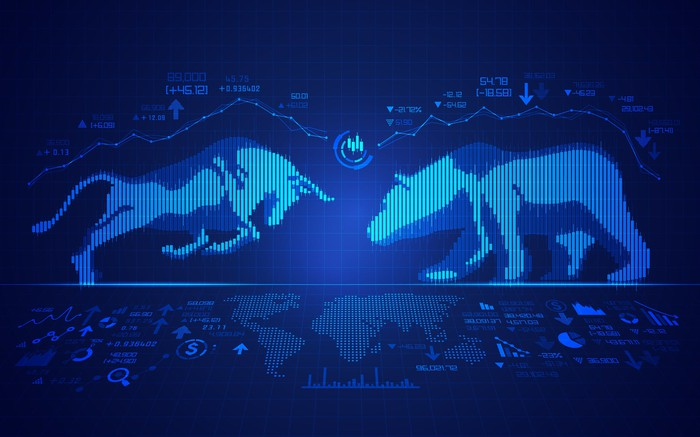 A bull and bear face each other on a digitized stock screen, which also displays a price chart and a world map.