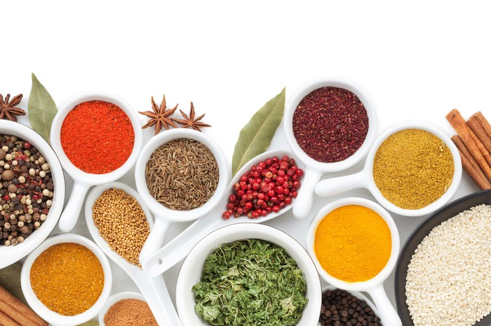 An assortment of spices laid out on a counter.