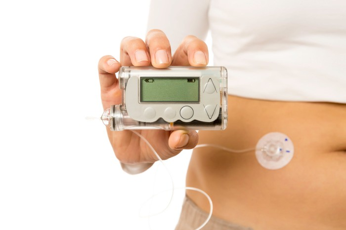 Diabetic patient holding a glucose monitor.