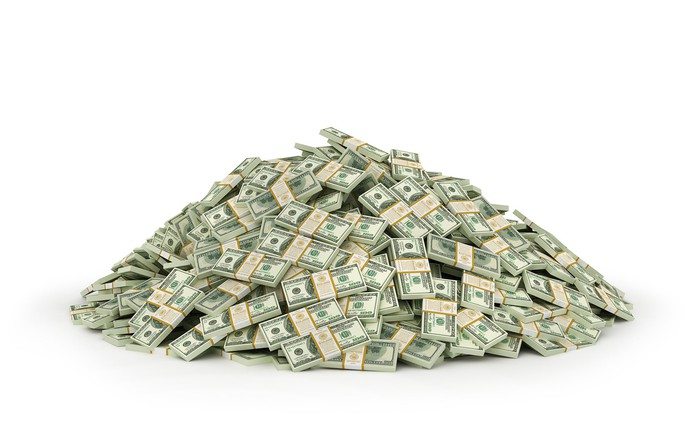 A big pile of cash with a white background.
