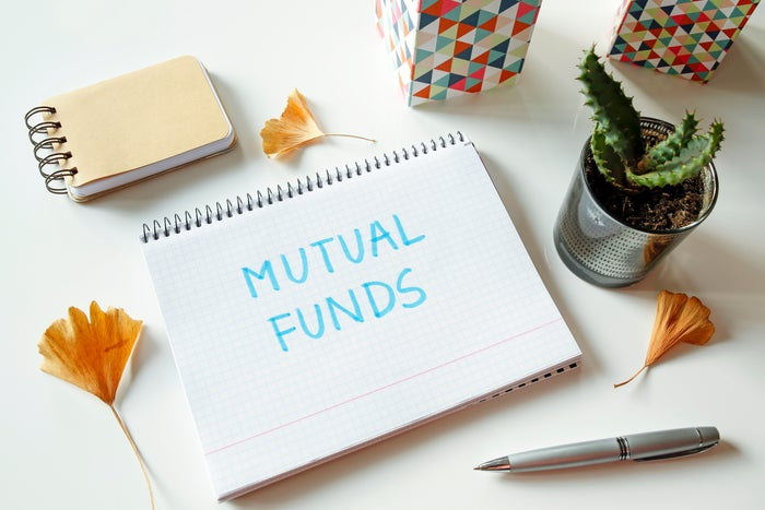 The words Mutual Funds written on a notepad