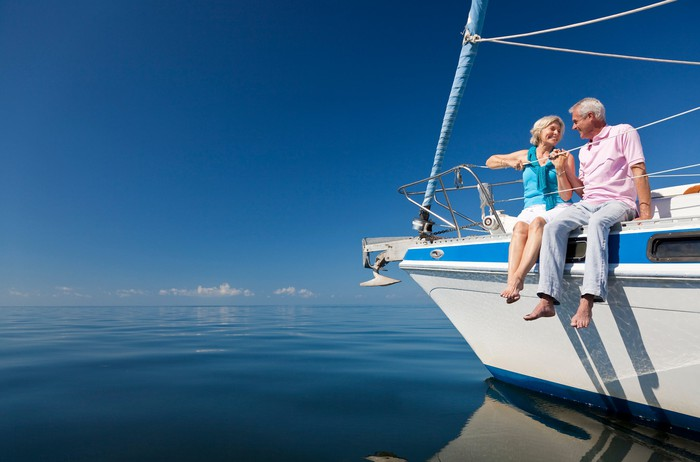Two old folks sitting on a yacht
