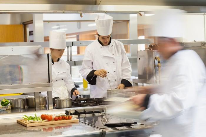 Two restaurant chefs at work in a kitchen
