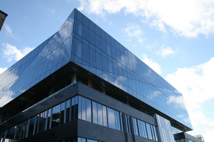 A glass and aluminum building exterior.