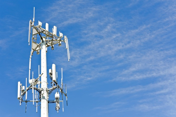 Photograph of 5g cell phone tower in blue sky