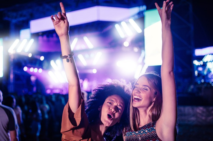 Two young women having fun at a music festival.