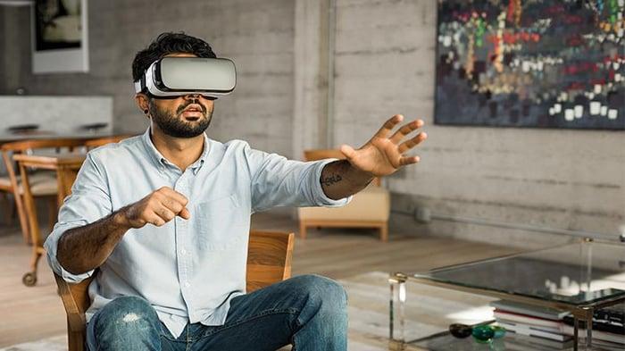 A man wearing an Oculus VR headset