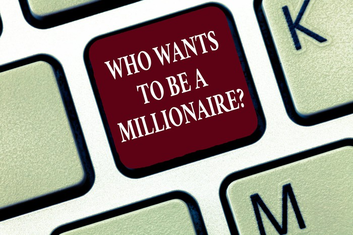 We see an illustration of a keyboard key, labeled who wants to be a millionaire?