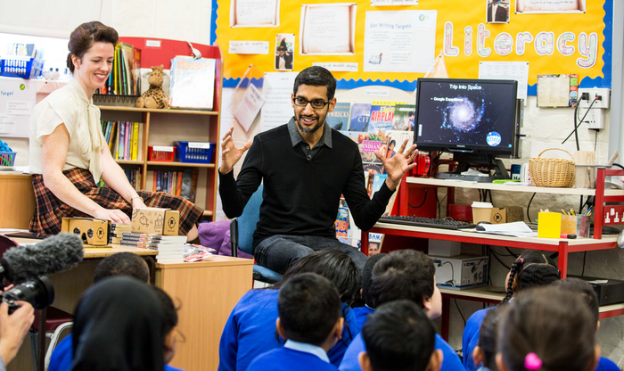 Sundar Pichai speaking to a classroom full of young students