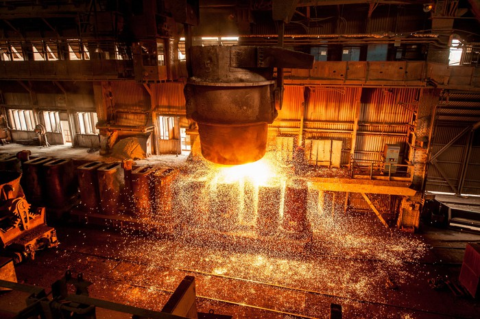 A tank spraying molten steel in a factory.