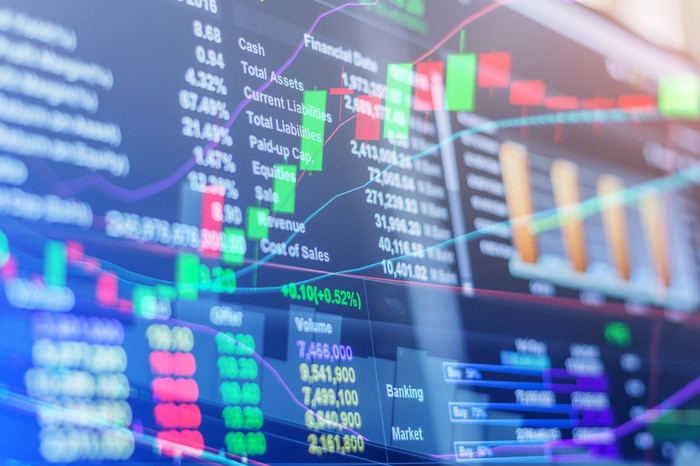 A screen shows stock market trading data.