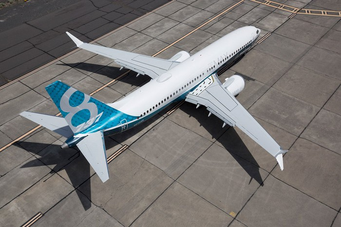 737 MAX 8 aircraft on a taxiway as seen from above.