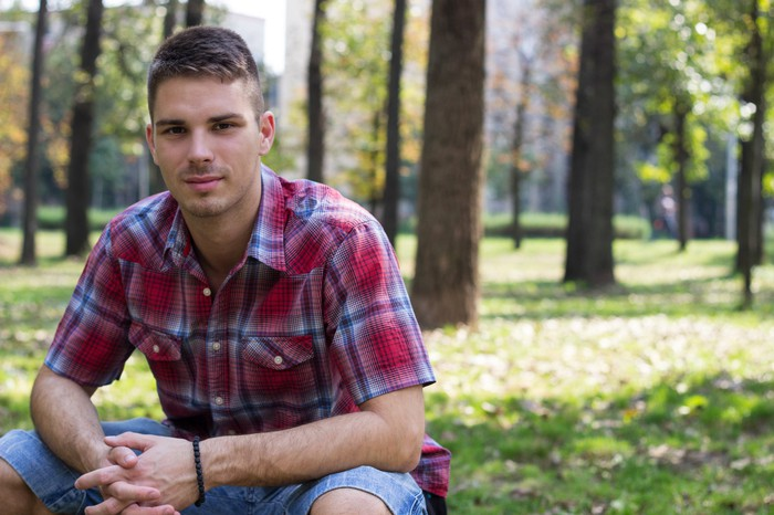 Man in plaid shirt outdoors