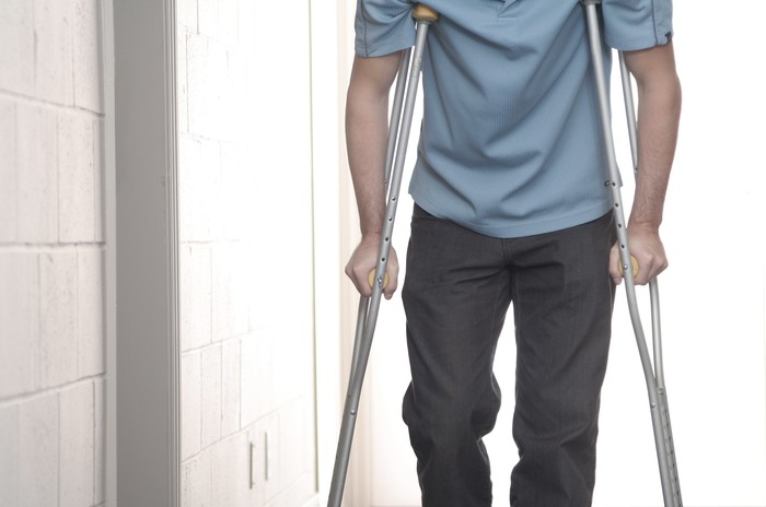 Man standing on crutches