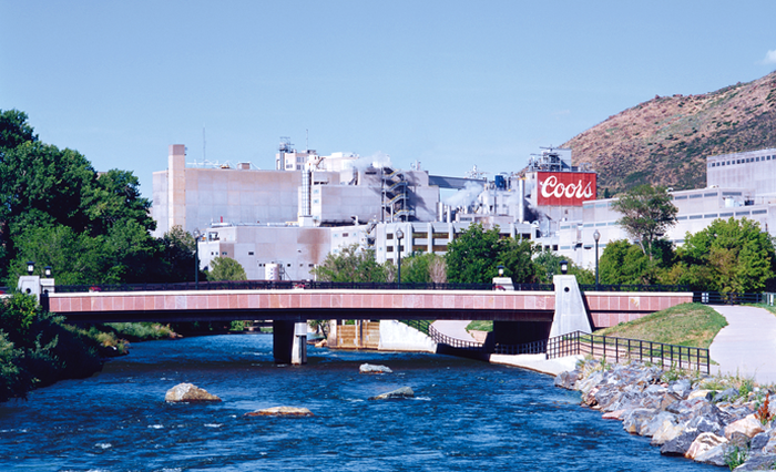 Exterior of Coors Brewery in Colorado, with river in foreground.