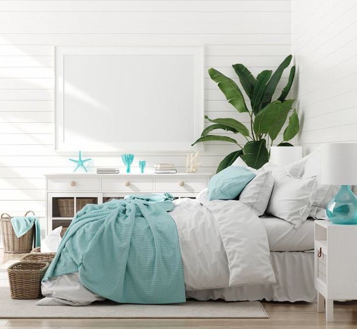 Bed with comforter, pillows, and other home decor.
