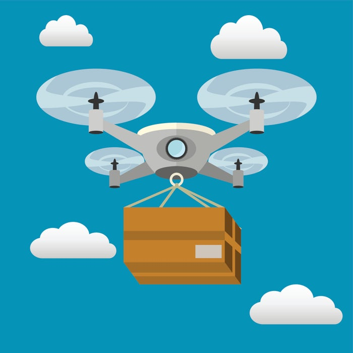 Quadcopter delivery drone carrying a package