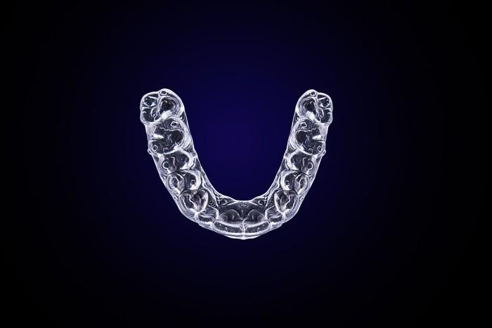 A clear teeth aligner