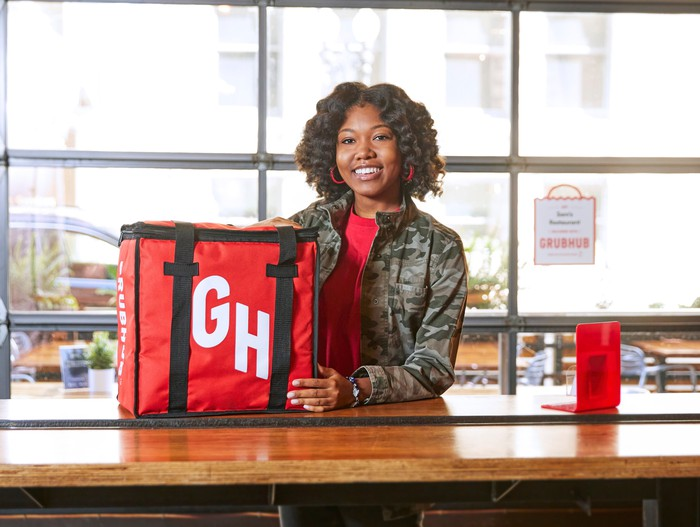 A woman delivers food for Grubhub.
