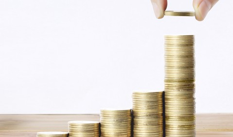 money coins stacked compound growth dividend