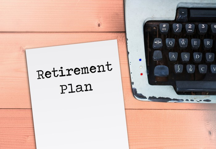 A sheet of paper next to a typewriter says retirement plan.