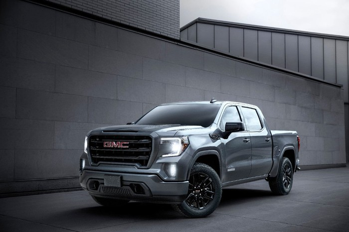 A 2020 GMC Sierra Elevation Crew Cab parked next to a building.
