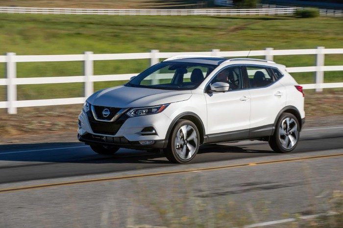 The 2020 Nissan Rogue, driving on a country road.