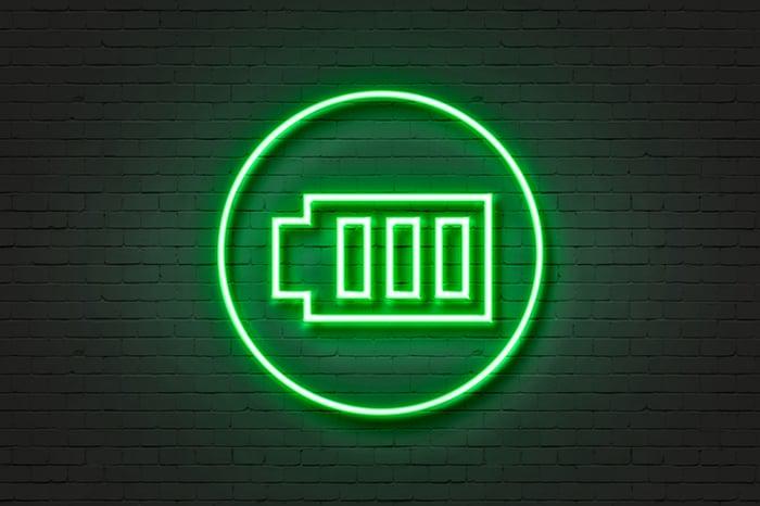A green neon light of a battery.